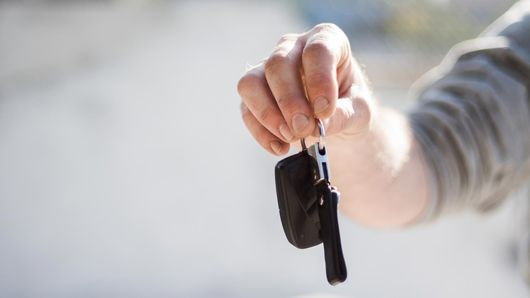 Car keys being given to the new owner